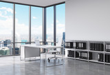 Fototapety A CEO workplace in a modern corner panoramic office in New York city. A white desk with a laptop, white leather chair and a bookshelf with black document folders. 3D rendering.