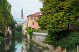 View of Retrone river and the clock tower of Vicenza, Italy, seen from Furo bridge poster