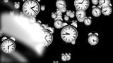Alarm clocks falling down with depth of field effect