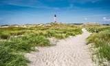 Dune landscape with lighthouse at North Sea - 93317464