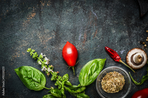 Basil and Tomatoes in rustic wooden background, ingredients for cooking  © VICUSCHKA