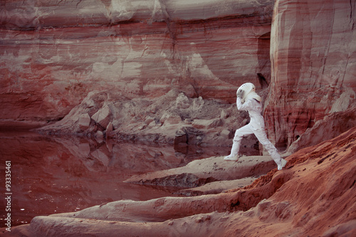 Fotobehang Bordeaux Water on Mars, futuristic astronaut, image with the effect of