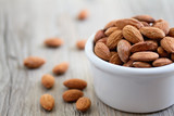 Fototapety Bowl of Almond Nuts on Rustic Wooden Table