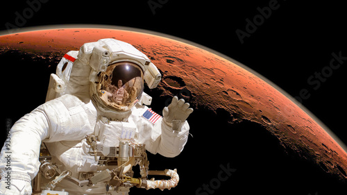 Close up of an astronaut in outer space, planet Mars in the background. Elements of the image are furnished by NASA