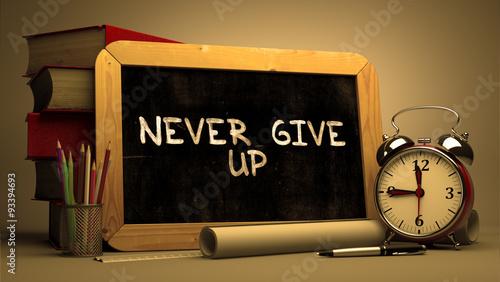 Fototapeta Never Give UpHandwritten by white Chalk on a Blackboard.