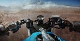 Fototapety Man driving on moto on big speed on mountain road