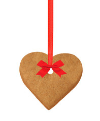 christmas heart cookie on red ribbon with bow isolated on white © wolfelarry