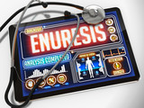 Enuresis on the Display of Medical Tablet.