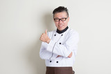Mature Asian Chinese chef giving thumb up