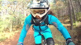 Biking as extreme and fun sport. Downhill Biking. Women in sport.