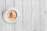 Fototapety coffee mug with christmas tree shape on white wood table