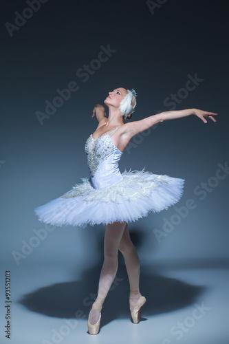 Naklejka Portrait of the ballerina in ballet tatu on blue background