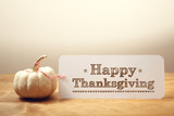 Happy Thanksgiving message with a white pumpkin