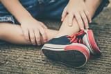 Fototapety youth sneakers on boy legs on road