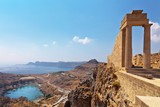 Greece. Rhodes. Acropolis of Lindos. Doric columns of the ancient Temple of Athena Lindia the IV century BC and the bay of St. Paul - 93594002