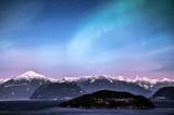 Northern lights aurora borealis in the night sky over beautiful lake landscape - Fine Art prints