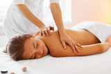 Fototapety Spa treatment. Woman enjoying massage in spa centre.