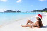 Christmas beach woman in santa hat on holidays