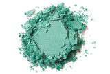 Green eye shadow, cosmetic crushed on white background