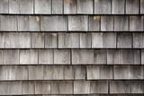 rows of weathered wood shingles on barn