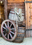 Barrels and wheel of a stagecoach. poster