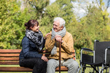 Elder man and carer