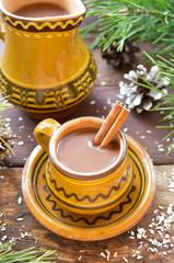 Mug of hot chocolate with cinnamon, christmas decoration