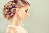 Fototapety Beautiful model with  elegant hairstyle . Beautiful woman with fashion wedding hairstyle and colourful makeup