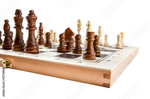 Zdjęcia Chess board with chess wooden pieces isolated on white