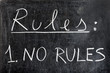 ������, ������: Rules list with one only rule: no rules handwritten with white chalk on dirty blackboard