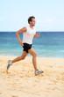 Detaily fotografie Sports fitness runner man jogging on beach