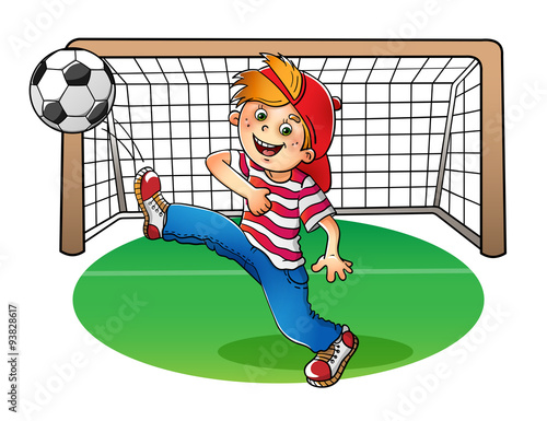 Boy in a red cap kicking a soccer ball