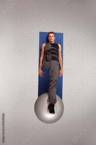 Poster Overhead view of man practicing pilates on large ball