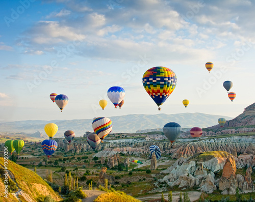 Deurstickers Ballon Colorful hot air balloons flying over Red valley at Cappadocia,