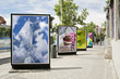 Постер, плакат: billboards with photographs at city street