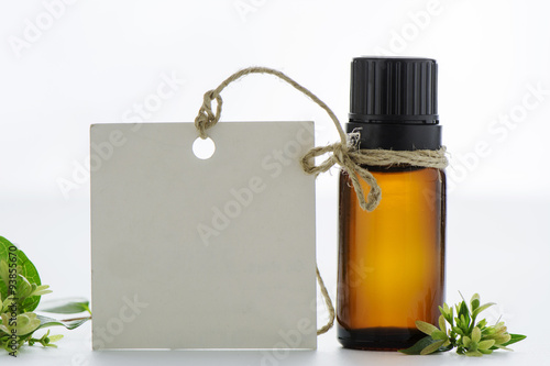 Essential oil, empty tags and  flowers Poster