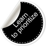 Learn to prioritize. Inspirational motivational quote. Simple trendy design. Black and white stickers. poster