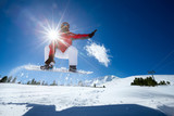 Snowboarder jumping in air