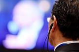 Man using translation headphones - 93886082