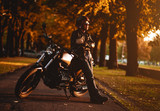 Fototapety Motorcyclist with a cafe-racer motorcycle outdoors