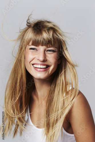 Young woman laughing in studio © sanneberg