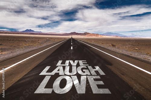 Poster Live Laugh Love written on desert road