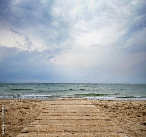 Bridge into the sea - loneliness concept - 93929426