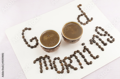 Two cups of coffee forming note
