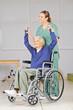Leinwanddruck Bild Alte Frau im Rollstuhl bei Physiotherapie