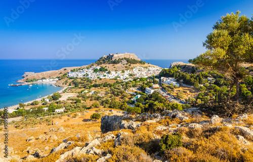 Sunny landscape of Lindos village with ancient castle