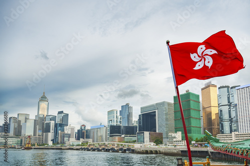 Poster Hong Kong Flag with urban background