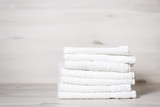 Fototapety stack of spa towels on white wooden table