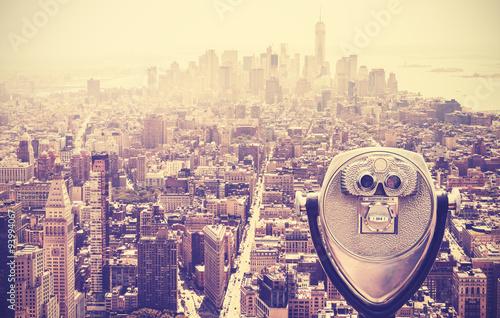 Retro vintage toned tourist binoculars over Manhattan, NYC, USA.