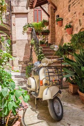 Fototapeta Vintage scooter on the beautiful porch in italy